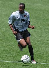 Soccer player dribbling the ball downfield