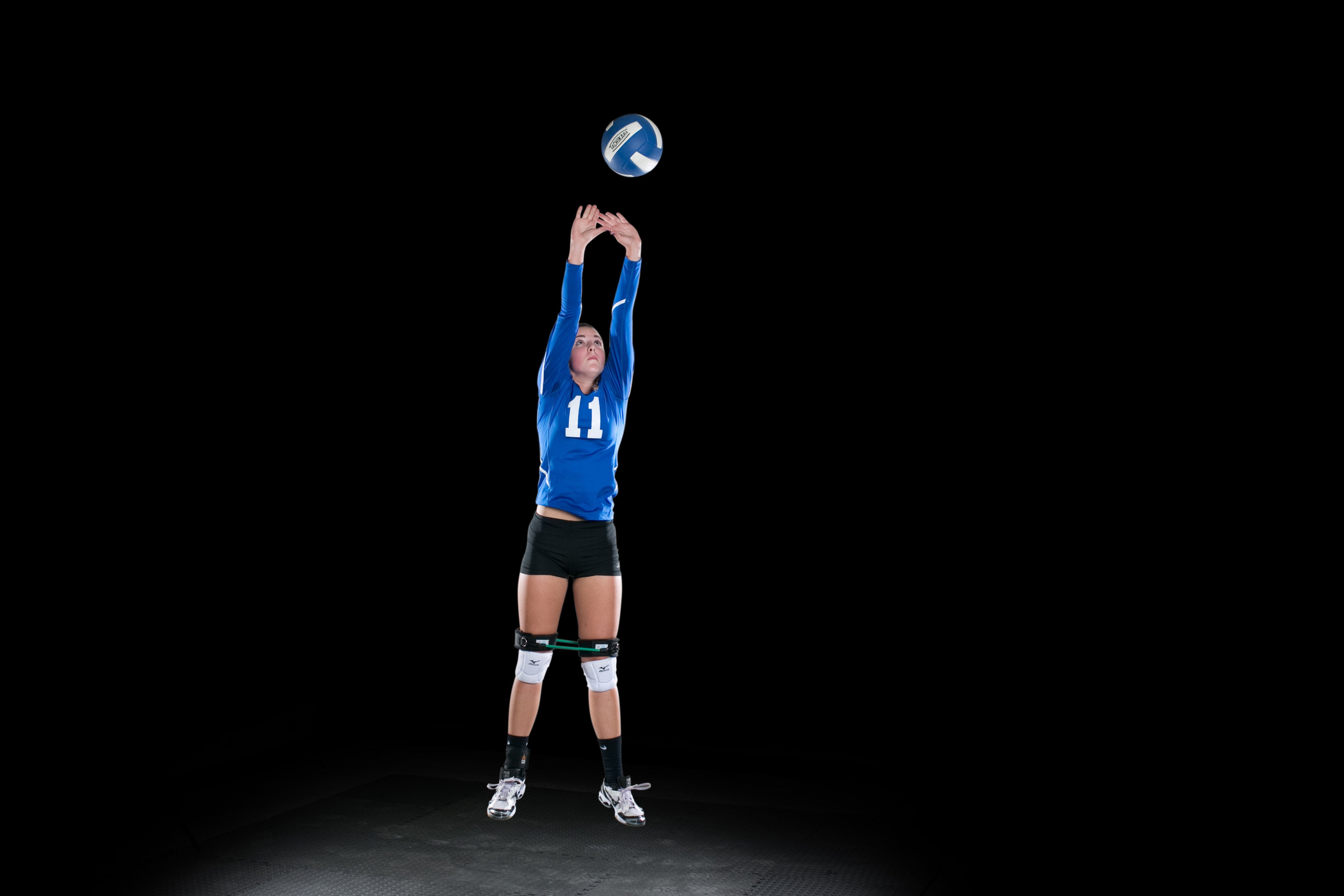 Volleyball Player hitting Volleyball